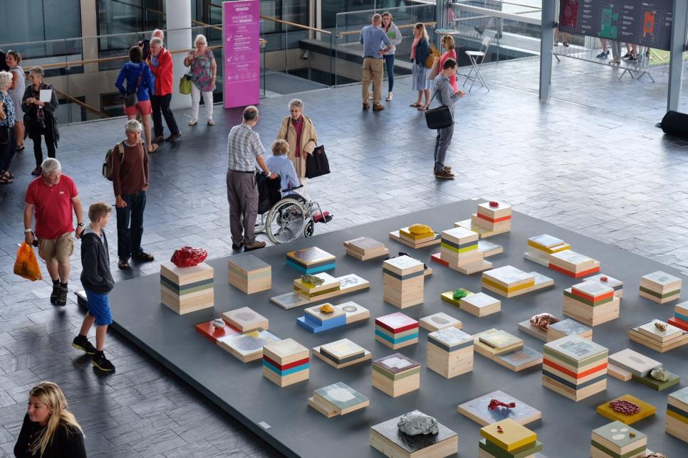 An arial-view of a colourful installation made out of boxes