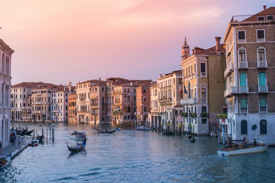 Boats and gondolas on a Venice canal