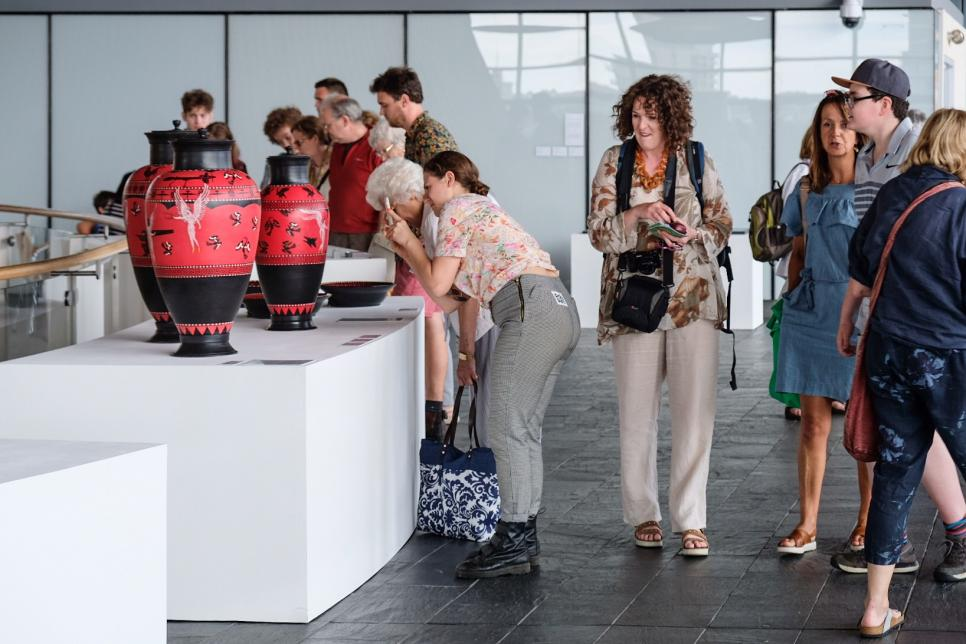 Visitors browsing the artwork on show at Y Lle Celf 2018 at the Senedd building in Cardiff.