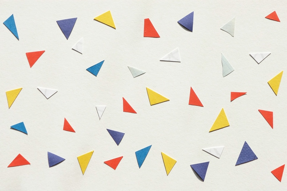 White background with colourful paper aeroplanes