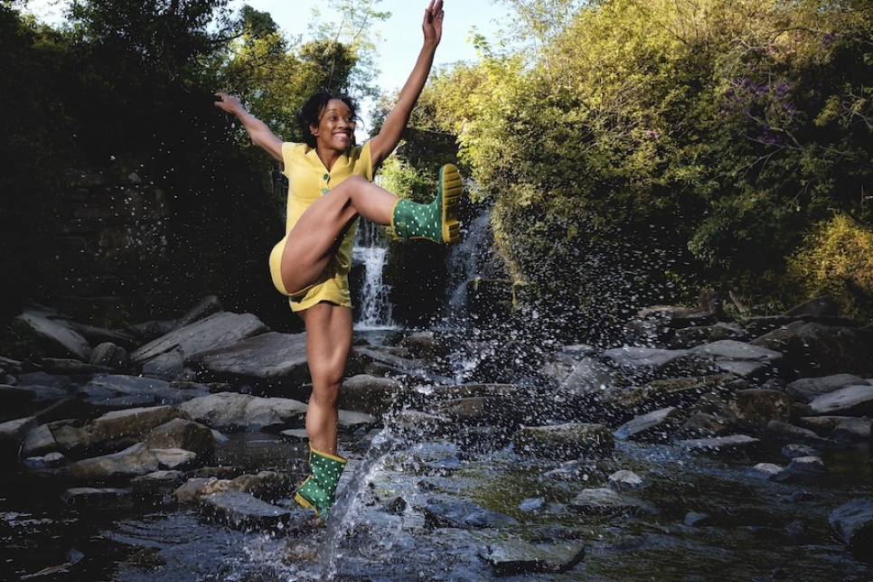 Woman kicking water and smiling