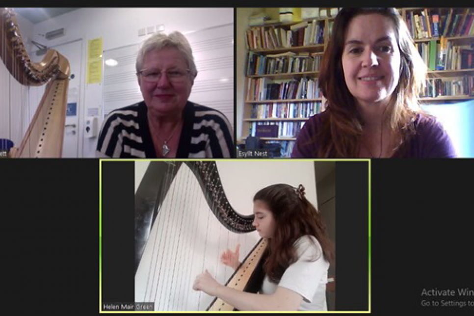 Image of 3 people having a harp lesson over zoom